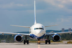 Close up image of passenger airplane. On the runway Stock Photography