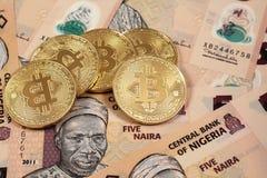 Close up of Bitcoins with Nigerian naira Stock Photo