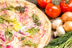 Close up image of pizza with vegetables around Royalty Free Stock Photo