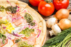 Close up image of pizza with vegetables around Royalty Free Stock Photography