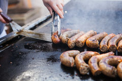 Close up image of pork sausages cooking on a flat Stock Photo