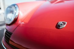 A close up image of the red vintage Porsche 911 coupe logo. Zilina, - Slovak Republic, August 4, 2018: A close up image of the red vintage Porsche 911 coupe logo royalty free stock photography