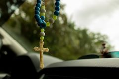 Close up image of Rosary beads hanging Inside a Car. In the Philippines royalty free stock images