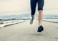 Close up image runner legs on asphalt Stock Photography
