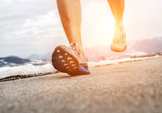 Close up image runner legs in running shoes Royalty Free Stock Photography