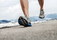 Close up image runner legs in running shoes Stock Photography