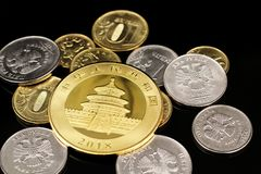 A close up image of Russian Federation coins with an American gold coin on a black background. A macro image of an assortment of Russian Federation coins with an stock images