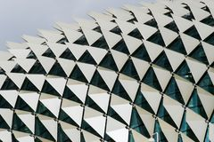 Close up detail of the roof of a building showing windows and triangular panels in a pattern. Close up image showing detail of the roof of a building showing Stock Image
