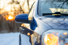 Close up Image of Side Rear-view Mirror on a Car in the Winter Landscape with Evening Sun Stock Photos
