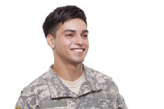Close-up image of a smiling young soldier. Smiling young soldier looking off camera stock images