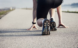 Close up image sprinter legs on the start Royalty Free Stock Images