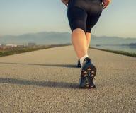 Close up image sprinter warming up legs Stock Photography