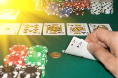 A close up image of stacked poker chips and a royal flush. A textured background.Copy paste place Stock Photo