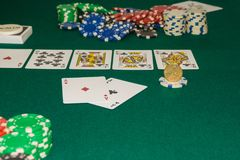 A close up image of stacked poker chips and a royal flush. A textured background.Copy paste place stock photography