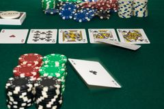 A close up image of stacked poker chips and a royal flush. A textured background.Copy paste place Stock Images