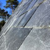 Close up image of a steep slate roof. Newly slated roof tiling Royalty Free Stock Photo