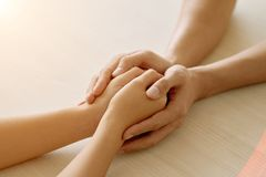 Supportive friend. Close-up image of supporting hands of friend Royalty Free Stock Photography