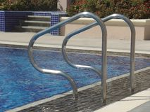 Close up image of swimming pool handrails. At an outdoor pool royalty free stock photo