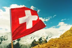 Close up image of swiss flag. In beautiful mountains landscape royalty free stock photo
