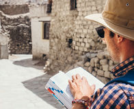 Close up image tourist with guide book on asian street royalty free stock images