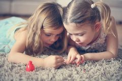 Close up image two little girls doing nails. stock photo