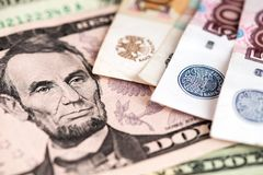 Russian Ruble banknotes and US Dollar. Close up image of US Dollar with Russian Rubles banknotes. US Dollar and Russian Ruble currency banknotes close up image stock photo