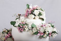 Close up image of Wedding Cake Topper with Sugar Flowers stock photography
