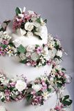 Close up image of Wedding Cake Topper with Sugar Flowers stock photo