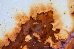 Close-up image of white colored old sheet of metal is covered by deep rust. stock photos