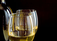 Close up image of white wine. Close up image of two glasses of white wine on black background Royalty Free Stock Image