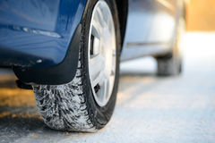 Close-up Image of Winter Car Tire on the Snowy Road. Drive Safe. Royalty Free Stock Photos