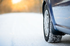 Close-up Image of Winter Car Tire on the Snowy Road. Drive Safe. Stock Image