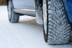 Close-up Image of Winter Car Tire on Snowy Road. Drive Safe Concept. Royalty Free Stock Photos