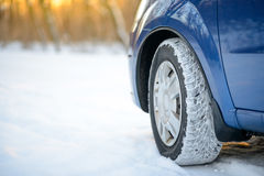 Close-up Image of Winter Car Tire on Snowy Road. Drive Safe Concept. Royalty Free Stock Images