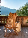 Image of wooden chair on balcony in alpine landscape royalty free stock photography