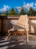 Image of wooden chair on balcony in alpine landscape royalty free stock photos