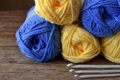 Yellow and Blue Crochet Yarn. A close up image of a yellow and blue crochet yarn and metal crochet hooks Royalty Free Stock Photo