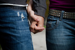Close-up image of a young couple holding hands Royalty Free Stock Images
