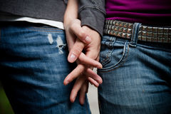Close-up image of a young couple holding hands Stock Images