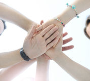 Close up image of young students making a stack of hands Royalty Free Stock Images