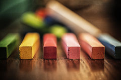 Colorful Chalk Sticks on Wooden Surface Royalty Free Stock Image