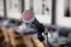 Close-up imprint of a red lipstick singer on a silver iron microphone on the stares on the stage. Concept live music in a. Restaurant or bar in the evening royalty free stock photos