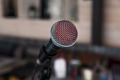 Close-up imprint of a red lipstick singer on a silver iron microphone on the stares on the stage. Concept live music in a. Restaurant or bar in the evening stock photo