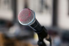 Close-up imprint of a red lipstick singer on a silver iron microphone on the stares on the stage. Concept live music in a. Restaurant or bar in the evening stock images