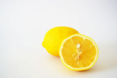 Close-up of incised lemons in the white background Stock Photography