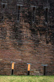 Close up of inclined brick tower. Close up of weathered brick tower Stock Photo