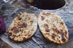 Close-up of Indian breads (Kulcha), Amritsar, Punjab, India. Close-up of Indian breads (Kulcha) on tandoor, Amritsar, Punjab, India Stock Image