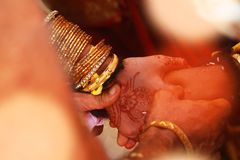 Close up of Indian bride and groom holding hands after the wedding ceremony,. Indian bride and groom holding hands after the wedding Royalty Free Stock Photos
