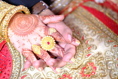 Close up of Indian bride and groom holding hands after the wedding ceremony Stock Photos