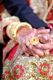 Close up of Indian bride and groom holding hands after the wedding ceremony Royalty Free Stock Photos
